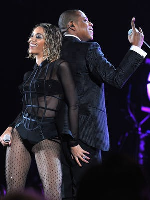 Beyonce and Jay-Z perform during the 56th Grammy Awards. The couple is embarking on a 16-city stadium tour.