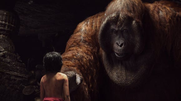 "Mowgli (Neel Sethi) talks to King Louie (Christopher Walken) in a scene from Disney's ""The Jungle Book."""
