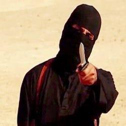 A black-clad militant, thought to be Jihadi John, with Japanese hostages Kenji Goto, left, and Haruna Yukawa.