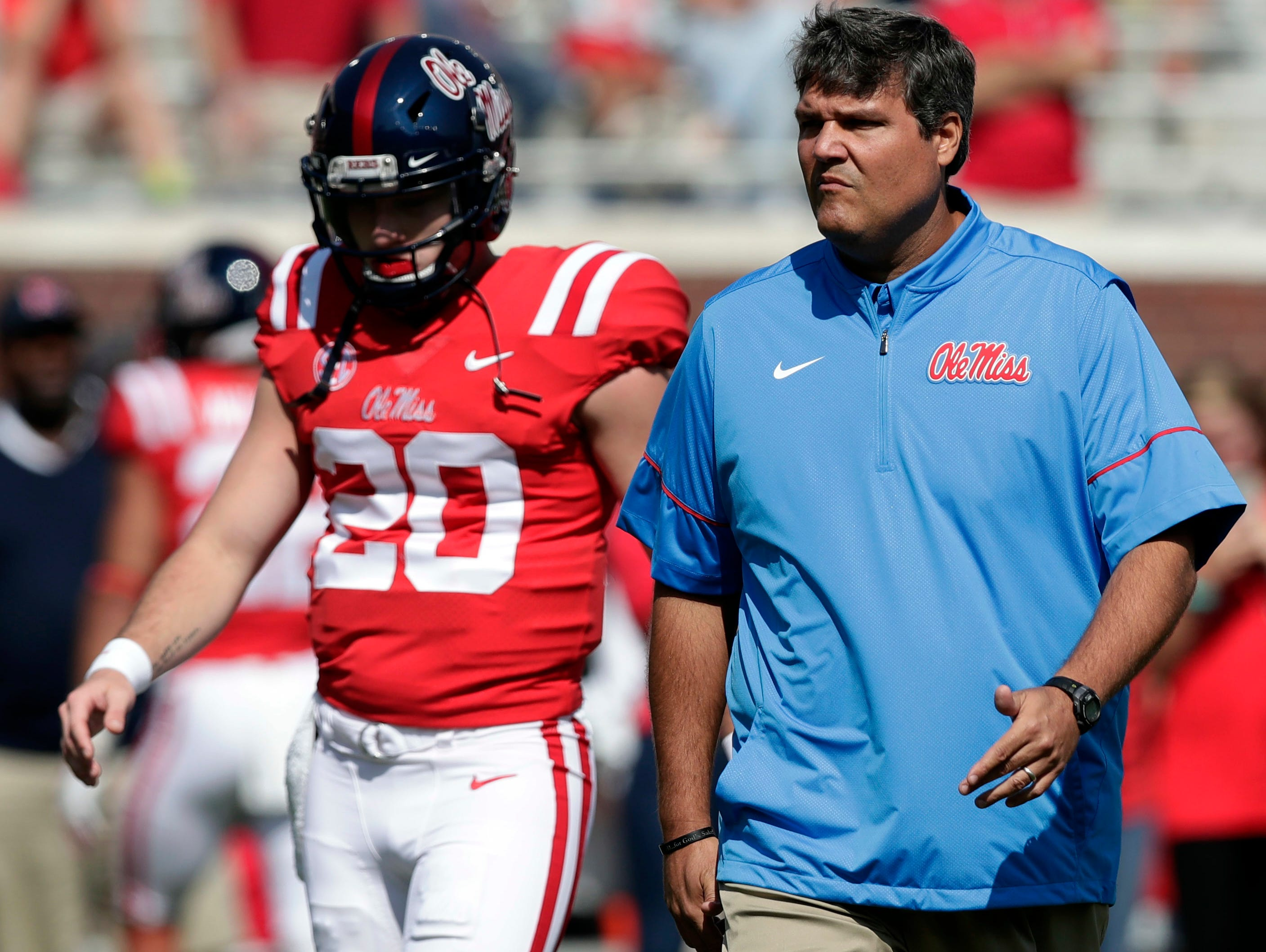 Mississippi quarterback Shea Patterson (20) walks with interim football coach Matt Luke during a pregame drills before an NCAA college football game against UT Martin in Oxford, Miss., Saturday, Sept. 9, 2017.(AP Photo/Rogelio V. Solis)