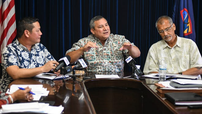 In this March 6 file photo, Gov. Eddie Calvo is flanked by members of his fiscal team at Adelup as he provides an update on measures being considered to address the government's budget shortfall.
