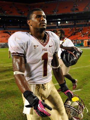 Florida State defensive back Tyler Hunter walks off the field after a game against the Miami Hurricanes at Sun Life Stadium in 2012.