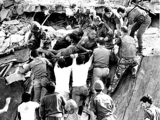 Bill Foley's photograph of British soldiers assisting rescue operations at the site of the bomb-wrecked U.S. Marine command center near Beirut airport on Oct. 23, 1983.
