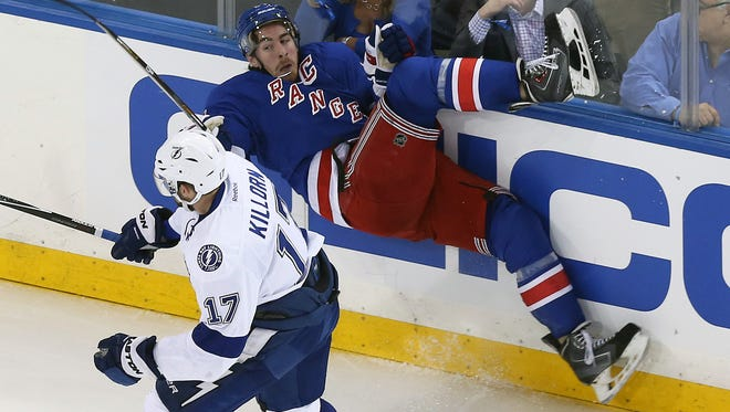 Rangers captain Ryan McDonagh is sent flying by Lightning forward Alex Killorn during the second period Monday night.