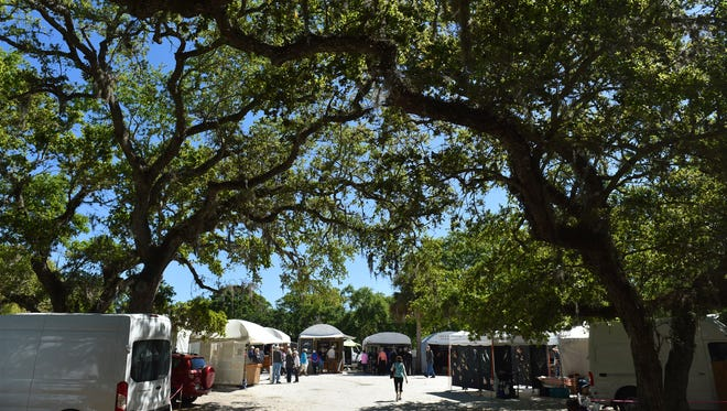 Opening day of the 67th annual Under the Oaks, Fine Arts & Crafts Show at Riverside Park on Friday, March 9, 2018, in Vero Beach. More than 200 artists have displays of artwork from paintings, photography, jewelry, sculptures, woodwork, and more among the oak trees throughout the park. The show, put on by the Vero Beach Art Club, continues 9 a.m. to 4 p.m. Saturday and Sunday. www.undertheoaksartshow.com