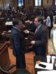 Reps. Stuart Bishop, R-Lafayette, and Rob Shadoin, R-Ruston, discuss legislation on the House floor.