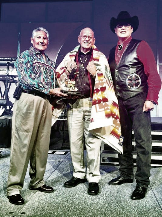 Courtesy   Former Mescalero Apache Tribal President Mark Chino, left, presents the 17th Annual Wendell Chino Humanitarian Award to W. Ron Allen. At right is Ernest Stevens Jr., chairman of the National Indian Gaming Association.
