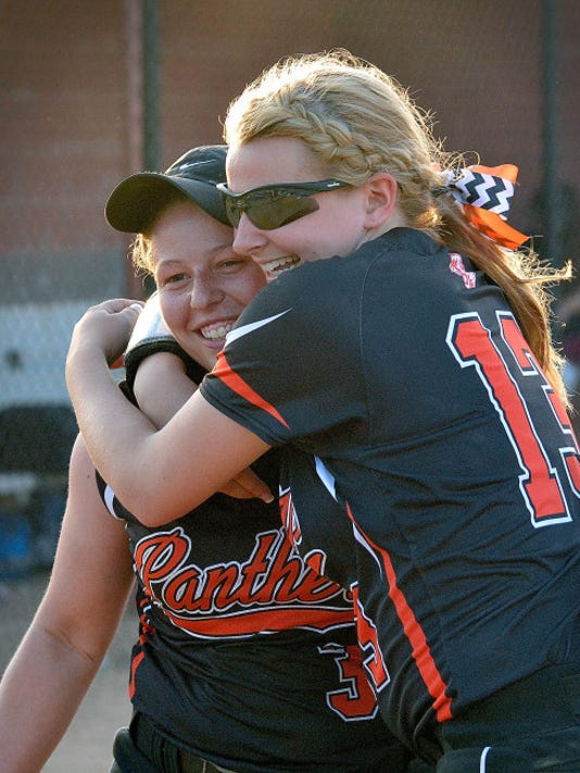 Central York's Kayla Resh, left, gets a congratulatory hug from teammate Kelsey Shifflett after the Panthers defeated Delone Catholic on Monday at New Oxford in the York-Adams League softball title game.