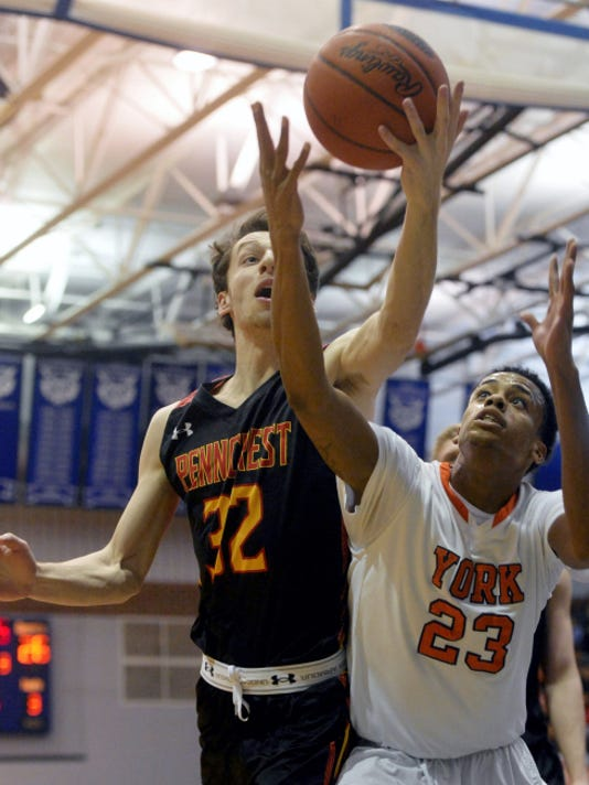 Penncrest's John Nichols, left, and William Penn's Jahaire Wilson fight for a rebound during Saturday's PIAA Class AAAA first-round game at Dallastown. Wilson scored a team-high 20 points to help William Penn win, 66-57.