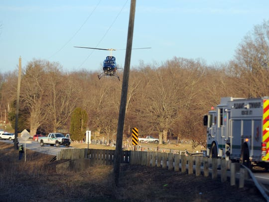 A medical helicopter prepares to land on U.S. 22 near