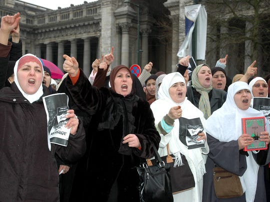 Muslims gather for a demonstration in front of Brussels justice palace in Feb. 2006, protesting the controversial cartoons of Prophet Mohammed first published in Danish newspaper Jyllands-Posten in September.