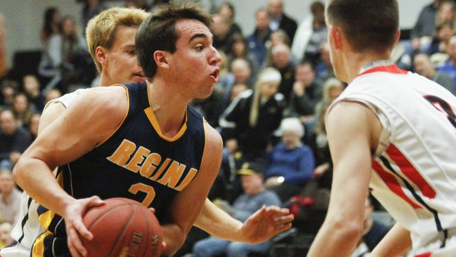Regina's Nathan Stenger drives into the paint during a game against West Branch on Friday, Dec. 18, 2015.
