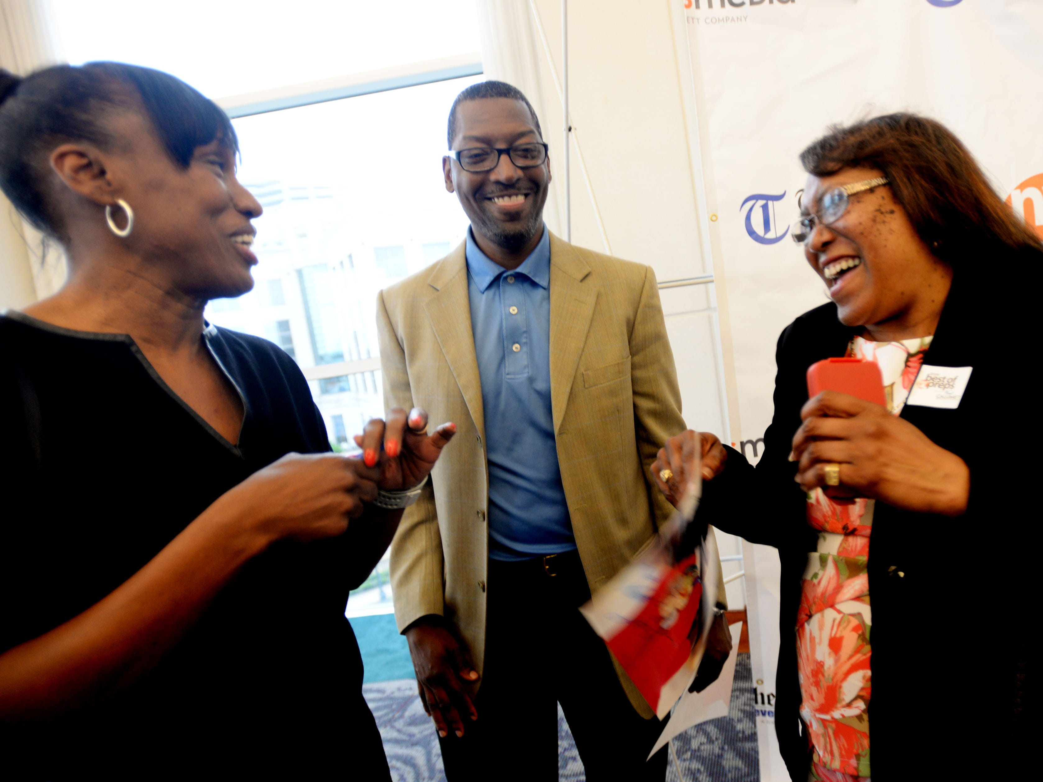 Deb Lyles (right) smiles as she meets Olympic medalists Jackie Joyner-Kersee and Hollis Conway at The Times' inaugural Best of Northwest Louisiana Preps banquet Tuesday evening at the Shreveport Convention Center.