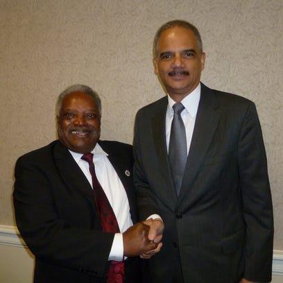 Rev. Tex Thomas, left, and former U.S. Attorney General