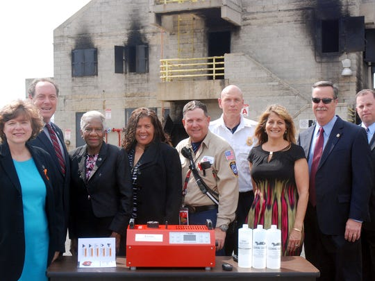 Phillips 66 recently donated a smoke generator to the Union County Fire Academy in Linden. Gathering to acknowledge the donation are, from left: Union County Freeholder Bette Jane Kowalski, Freeholder Chairman Bruce H. Bergen, Freeholders Vernell Wright and Linda Carter, Bayway Refinery Fire Chief Jeff Merrill, Union County Fire Academy Dean Deputy Chief Steve Ruhl, Phillips 66 Community Relations Coordinator Mary Phillips, Union County Public Safety Director Andrew Moran and Union County Emergency Services Director Christopher Scaturo.