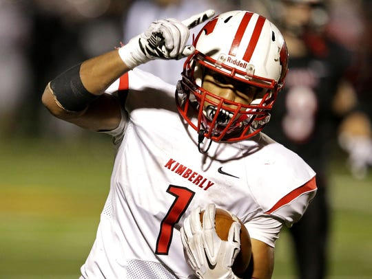 D.J. Stewart of Kimberly celebrates a touchdown against