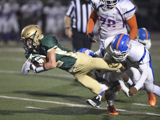 0910-Adam-Mieczkowski-reaches-out-for-extra-yards.JPG