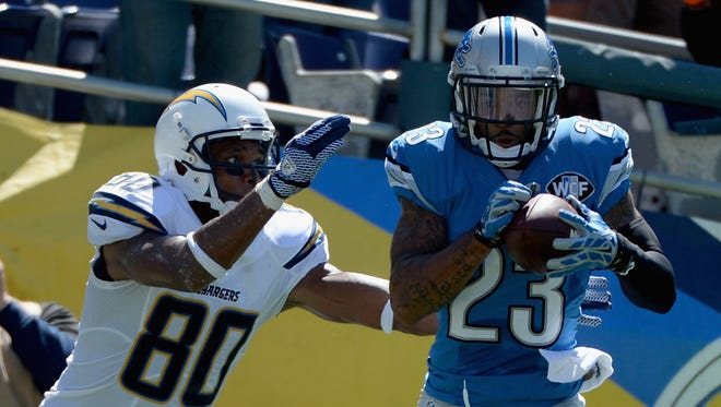 Cornerback Darius Slay of the Detroit Lions intercepts a pass against the San Diego Chargers on Sept. 13, 2015, in San Diego.
