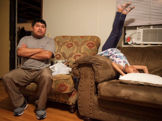 Victor Magadon shares time with his daughter Jessica at their home Wednesday. Magadon is concerned about having to move his family's trailer from the Holiday Park Mobile Home park after being evicted by the park's management company.