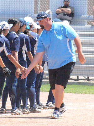 Silver head softball coach Duane Trewern shakes his team's hands after winning his sixth straight state championship earlier in the month in Albuquerque.