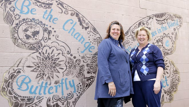 Janna Zimmerman, friend of the Brown County Breast Feeding Coalition, and Beth Metsa, coalition treasurer, stand in front of a new butterfly mural that was installed Saturday in downtown Green Bay.