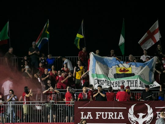 "Phoenix Rising fans hold up a flag saying ""Dismember"