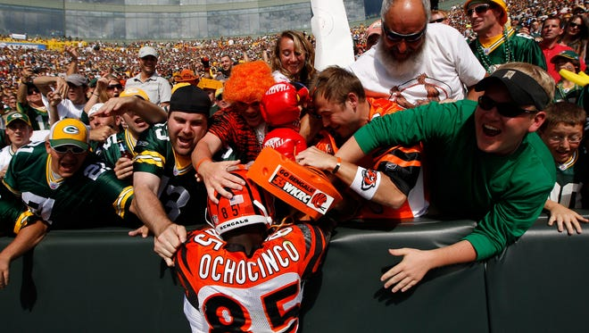 As Ochocinco, Chad Johnson took his shot at a Lambeau leap at Green Bay after a touchdown catch in 2009. The Enquirer/Jeff Swinger