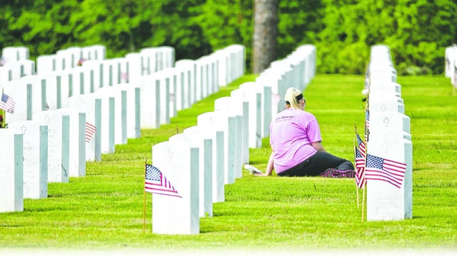 Visitors remember loved ones interred at Barrancas National Cemetery in Pensacola.