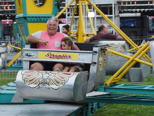 Gary Newman of the Town of Poughkeepsie rides the Scrambler with his son Benjamin at the 2017 Ulster County Fair in New Paltz.