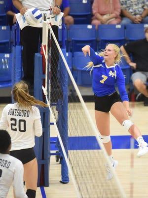 Mountain Home's Leah Jackson hits for a point against Jonesboro on Tuesday night.