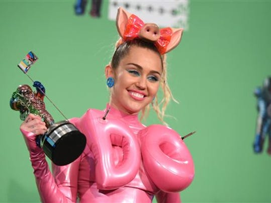 Miley Cyrus poses in the press room at the MTV Video Music Awards at the Microsoft Theater on Sunday, Aug. 30, 2015, in Los Angeles. (Photo by Richard Shotwell/Invision/AP)
