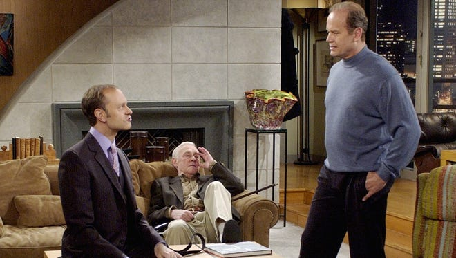 """Frasier (Kelsey Grammer, right) talks with his brother Niles (David Hyde Pierce, left), as their father (John Mahoney) looks on in the final episode of """"Frasier."""""""