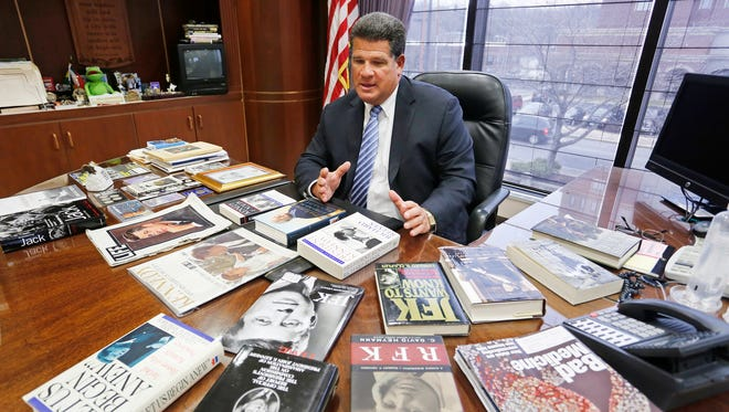 Mayor Tony Roswarski talks about his collection of books on the Kennedys Thursday, March 26, 2015, in his office inside Lafayette City Hall. Roswarski has a large collection of political memorabilia, much of it devoted to the Kennedys.
