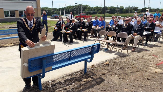 Denis Stubbs, Senior Grand Steward of the Grand Lodge of Iowa, uses a ceremonial level during a cornerstone ceremony at Tiffin Elementary on Saturday.