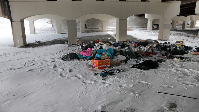Discarded clothing, bedding and garbage were left in two big piles underneath the Frederick Douglass-Susan B. Anthony Memorial Bridge at the former site of Sanctuary Village, a temporary encampment for the homeless.