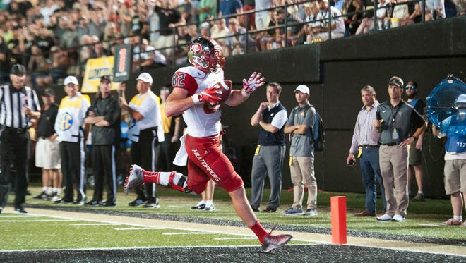 Sep 3, 2015; Nashville, TN, USA; Western Kentucky Hilltoppers tight end Tyler Higbee (82) scores a touchdown during the second half against Vanderbilt Commodores at Vanderbilt Stadium. Western Kentucky Hilltoppers won 14-12. Mandatory Credit: Joshua Lindsey-USA TODAY Sports