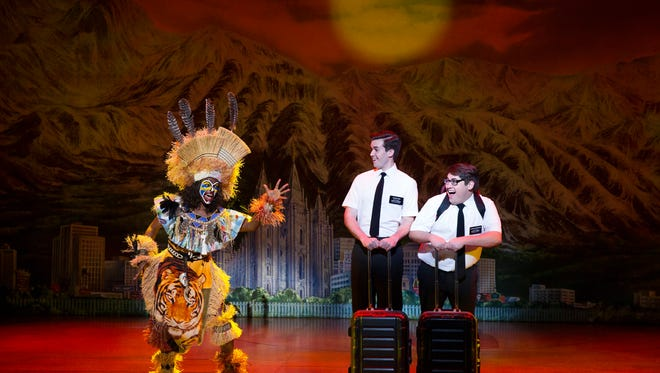 "In ""The Book of Mormon"" two young Mormon missionaries arrive in a remote Ugandan village and discover that they are not remotely prepared to deal with the issues that face the people there – or their lack of interest in their message. Broadway in Cincinnati is presenting the show July 31-Aug. 5 at the Aronoff Center. Seen here are (from left) Monica L. Patton, Kevin Clay as Elder Price and Conner Peirson as Elder Cunningham."
