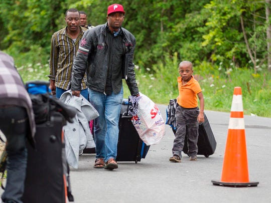Asylum seekers arrive at the U.S.-Canadian border near Champlain, N.Y.