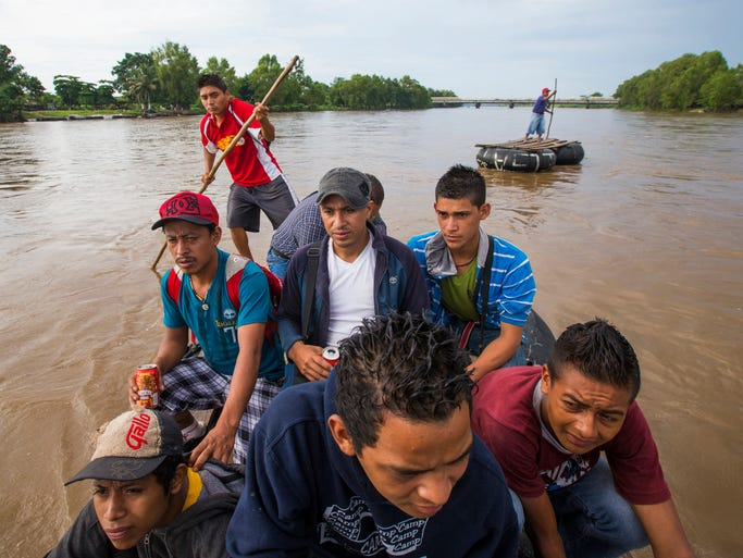 Migrants from Central America cross illegally into Mexico from Guatemala using a raft on the Suchiate River June 22. They were all headed for the U.S. but weren't sure which route they would take through Mexico. Violent crime and, to a lesser extent, lack of work, have sent people from Central America to the U.S. in increasing numbers. Minors on this raft include Jairo Garniga, 16, from Guatemala (front left) and Antoni Castellan, 17 from Honduras (front right).