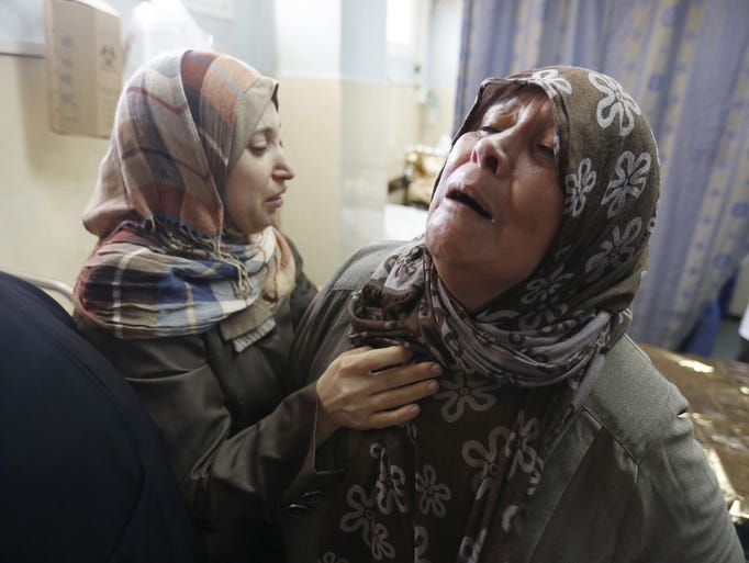 Palestinian women from the al-Dalo family react at the al-Shifa hospital in Gaza Cityon Aug. 20as victims are brought tothe morgue to be prepared for burial after the al-Dalo home was destroyed the night before in an Israeli airstrike on Gaza City's Sheikh Radwan neighborhood.