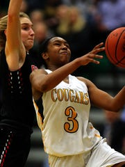 Montgomery's Bria Johnson drives to the hoop. Tuesday