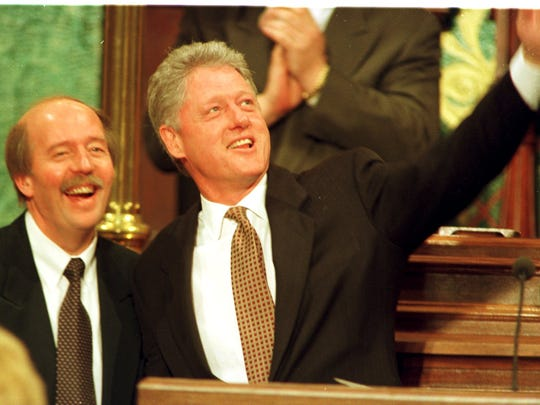 President  Bill Clinton waves goodbye as Speaker of the House Curtis Hertel stands to the left, Thursday at the State Capital in Lansing, March 6, 1997.