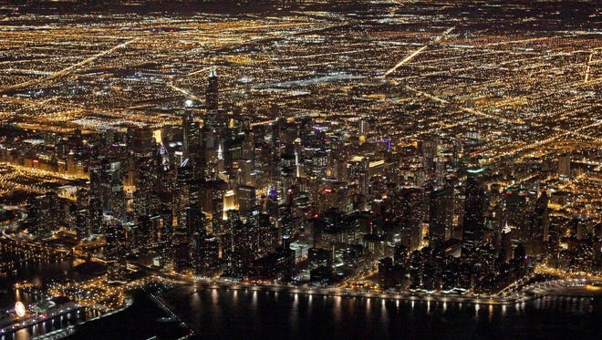 """An aerial view at night of the downtown Chicago skyline. """"Star Wars"""" creator George Lucas has selected Chicago to build his museum of art and movie memorabilia."""