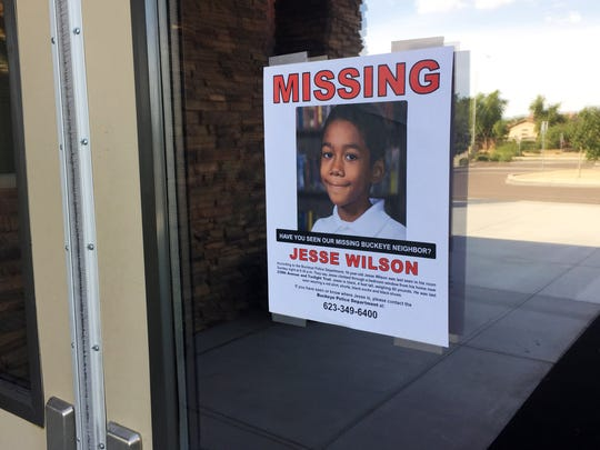 A missing poster for 10-year-old Jesse Wilson of Buckeye, at  Bradley Creemos Academy in Goodyear, where Jesse goes to school on July 20, 2016.