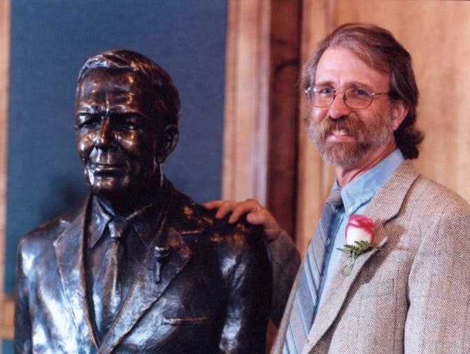 Beckwith with statue
