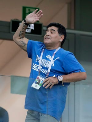 Argentina's former soccer star Diego Maradona cheers for his team before the group D match between Argentina and Croatia at the 2018 soccer World Cup in Nizhny Novgorod Stadium in Nizhny Novgorod, Russia.