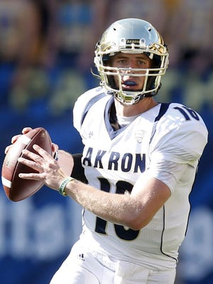 Sep 27, 2014; Pittsburgh, PA, USA; Akron Zips quarterback Kyle Pohl (16) looks downfield for a receiver against the Pittsburgh Panthers during the third quarter at Heinz Field. The Akron Zips won 21-10. Mandatory Credit: Charles LeClaire-USA TODAY Sports
