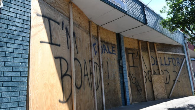 Several stores along Castle St. were damaged and boarded up in Wilmington , N.C., Monday, June 1, 2020. Sunday night's protest turned confrontational as protesters and police clashed a day after a peaceful protest was held to show solidarity with George Floyd.