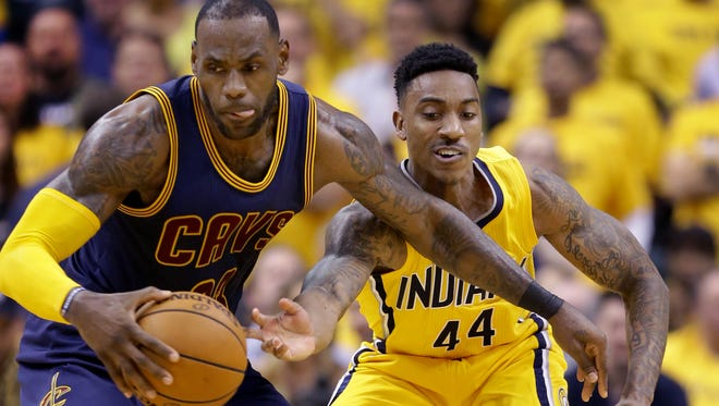 Indiana Pacers guard Jeff Teague (44) attempts to swipe the ball from Cleveland Cavaliers forward LeBron James (23) in the first half  of their NBA playoff game Thursday, April 20, 2017, evening at Bankers Life Fieldhouse.