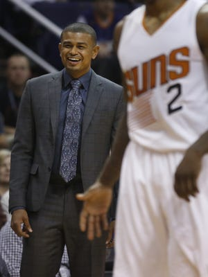 Suns head coach Earl Watson laughs at a call against his team during a game against the Nuggets at Talking Stick Resort Arena on November 27, 2016 in Phoenix, Ariz.